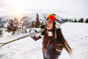 FR_ski_storage_woman_holding_skis_laughing