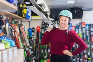 Buying_skis_web_woman_holding_skis